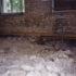 basement floor has been jackhammered and lies in heaps of concrete