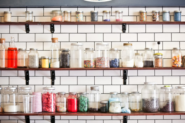 3 shelves of candy jars by Leif Norman