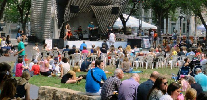 Bustling crowds watching a Fringe Festival concert in Old Market Square