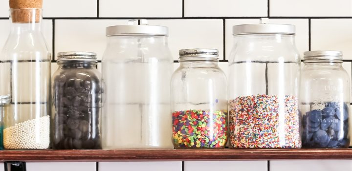 candy shelf with half-filled jars by Leif Norman