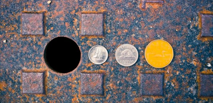 photograph of coins on manhole cover